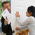 A salesman is using door knocking security sales tactics to pressure a lady in to singing a long-term contract.