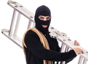 Burglar taking advantage of a security mistake and using a ladder.