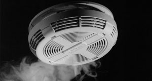 An ionization/photoelectric smoke detector is detecting smoke and about to go into alarm.