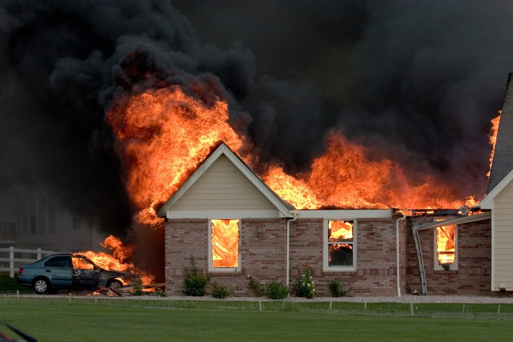 A house caught on fire and the smoke alarms notified the monitoring station.